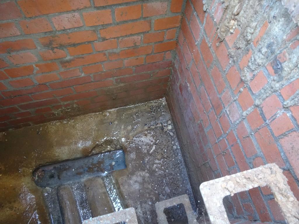Leaking water entering manhole