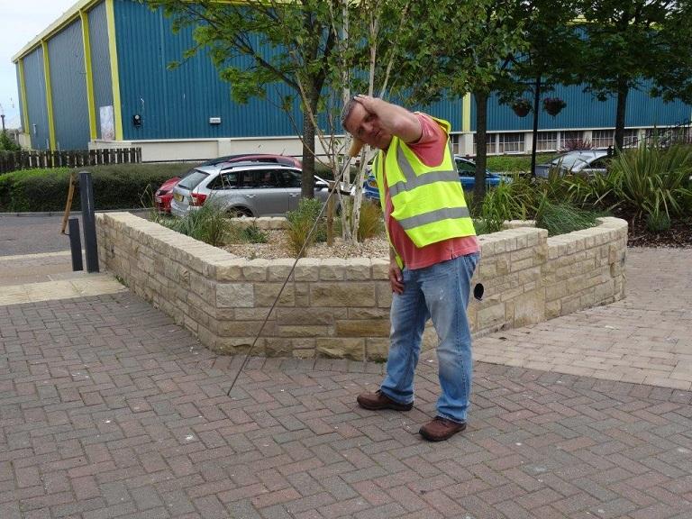 Graham Mann Water Audit Expert using a listening stick
